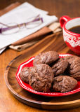 Homemade chocolate cookies on red plate Stock Images