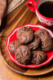 Homemade chocolate cookies on red plate Stock Photography