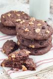 Homemade chocolate cookies with walnuts and chocolate chips on table, vertical Royalty Free Stock Images
