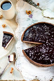 Homemade chocolate cream tart with blackberry jelly and walnuts Stock Photo
