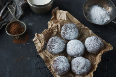 Homemade chocolate crinkles in powdered sugar, chocolate cookies with cracks and a glass of milk Royalty Free Stock Photos