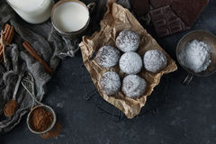 Homemade chocolate crinkles in powdered sugar, chocolate cookies with cracks and a glass of milk Royalty Free Stock Photography