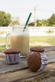 Homemade chocolate cupcake with a glass of ice coffee on wood ta Stock Photo