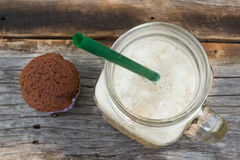 Homemade chocolate cupcake with a glass of ice coffee on wood ta Royalty Free Stock Photography