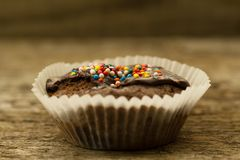Homemade chocolate cupcake on wooden background Royalty Free Stock Images