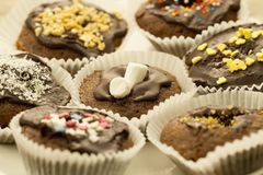 Homemade chocolate cupcakes decorated with a decorative topping Royalty Free Stock Image