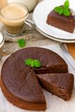 Homemade chocolate fondant cake with mellow filling for coffee. Homemade chocolate fondant cake with mellow filling with a leaf of mint for coffee royalty free stock photo
