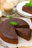Homemade chocolate fondant cake with mellow filling for coffee. Homemade chocolate fondant cake with mellow filling with a leaf of mint for coffee stock image