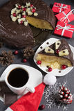 Homemade chocolate-glazed pineapple cake and a cup of coffee with three pieces of chocolate with christmas decorations Royalty Free Stock Photos