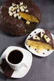 Homemade chocolate-glazed pineapple cake and a cup of coffee with three pieces of chocolate Royalty Free Stock Photo