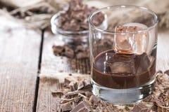 Homemade Chocolate Liqueur. Homemade brown Chocolate Liqueur with some fresh pieces of chocolate Royalty Free Stock Image