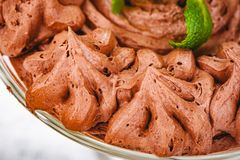 Homemade chocolate mousse in portion glass on wooden background. Close up stock photos
