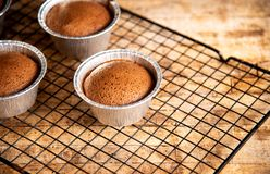 Homemade chocolate muffins in aluminum cups. Top view royalty free stock images