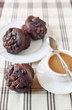 Homemade chocolate muffins/buns with cup of coffee. Indoors stil Stock Images