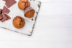 Homemade chocolate muffins on a wooden board Royalty Free Stock Photos