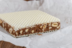 Homemade chocolate nougat with nuts. On wooden background. Traditional italian cuisine Stock Image