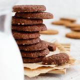 Homemade oatmeal cookies. Homemade chocolate oatmeal cookies with milk close up royalty free stock photos