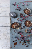 Homemade chocolate pastries on vintage molds on rustic blue table Royalty Free Stock Image