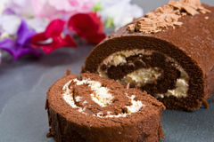 Homemade chocolate roll with fresh flowers Royalty Free Stock Photos