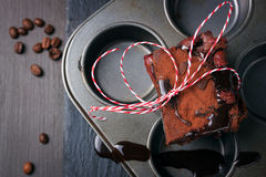 Homemade chocolate sweet brownies cakes with cherry and chocolate sauce or syrup on a dark background, horizontal Stock Image