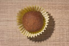Homemade chocolate truffle. Flat lay design of candy ball over stock photo
