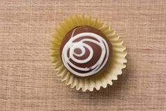 Homemade chocolate truffle. Flat lay design of candy ball over stock images