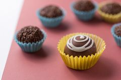 Homemade chocolate truffle surrounded by brigadeiro candy, brazilian dessert. royalty free stock images