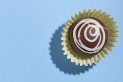 Homemade chocolate truffle. Top view of candy on blue backgroun stock photography