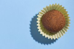 Homemade chocolate truffle. Top view of candy on blue backgroun royalty free stock image