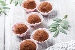 Homemade Chocolate truffles candy dessert on wooden background close up. Delicious chocolate praline with decor royalty free stock image