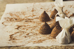 Homemade chocolate truffles on cooking paper copy space Royalty Free Stock Images