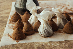 Homemade chocolate truffles on cooking paper Royalty Free Stock Image