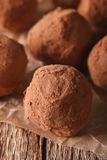 Homemade Chocolate truffles macro on a table in a rustic style. Stock Photos