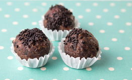 Homemade chocolate truffles in paper holders Royalty Free Stock Image