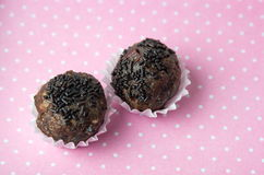 Homemade chocolate truffles in paper holders Royalty Free Stock Images