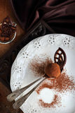 Homemade chocolate truffles in two spoons Royalty Free Stock Photo