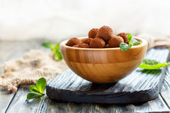 Homemade chocolate truffles in a wooden bowl. Stock Photography