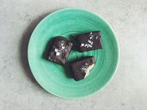 Homemade chocolates filled with almond butter, topped with sea salt Stock Image