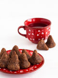 Homemade chocolates and tea. Homemade chocolate candies on a saucer and tea Royalty Free Stock Images