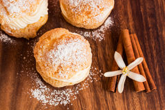 Homemade Choux pastry with cream on the wood board Royalty Free Stock Photo