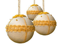 Homemade christmas balls coated with golden fabric. Royalty Free Stock Photography