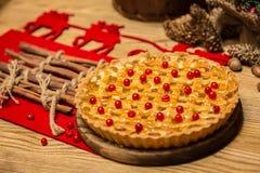 Homemade christmas cake with wild berries. Stock Photos
