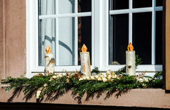 Homemade christmas candles making from birch wood. Countryhouse window decoration Royalty Free Stock Image