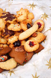 Homemade christmas cookies. A lot of beautiful homemade christmas cookies with nuts, almonds and jam isolated as a vertical image Stock Photo