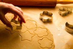 Homemade Christmas cookies on baking paper Royalty Free Stock Photos