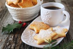 Homemade Christmas cookies and cup of coffee. Homemade Christmas cookies, cup of coffee and holly Royalty Free Stock Photos