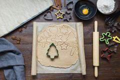 Homemade christmas cookies on parchment. Xmas. The process of baking homemade cookies. View from above. stock photography