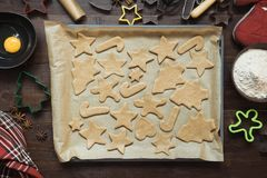 Homemade christmas cookies on parchment. Xmas. The process of baking homemade cookies. View from above. royalty free stock photo