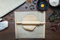 Homemade christmas cookies on parchment. Xmas. The process of baking homemade cookies. View from above. stock photo