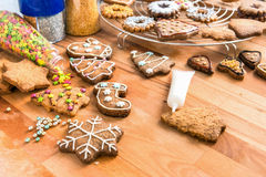 Homemade christmas cookies ready for decoration. Stock Photos